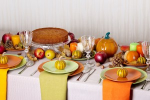 Thanksgiving dinner. Seasonal table setting with autumn leaves,