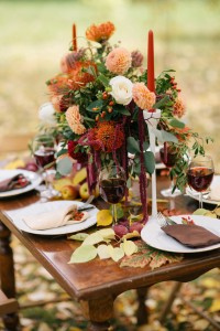 The holiday table decorated with flowers.